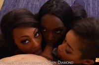 Hot ebony babes take turns sucking a big