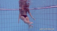 Takes off bikini in the pool