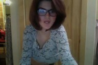Brunette with glasses shows her big boobs