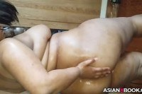 Asian babe inserts bottle