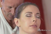 Brunette ed by masseur in massage room