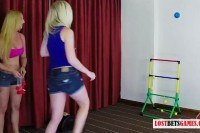 Blondes play a strip game of throw the balls