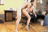 Blonde office girl bent over her chair and