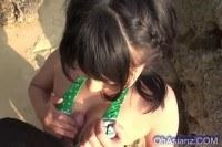 Cute asian girl sucking cock at the beach
