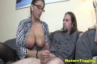Spex milf gets cumshot after giving handjob